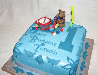 1st birthday  cake with sugar toys