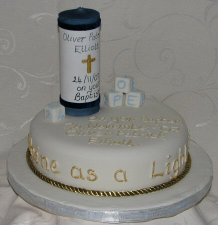 baptism cake with candle