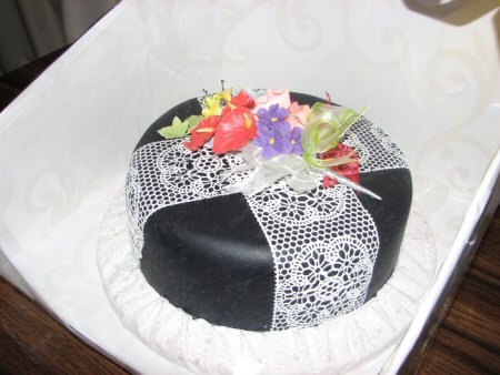 Black cake with white edible lace