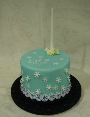 sugar candle on a blue christmas cake