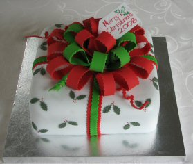 christmas present parcel cake bows and ribbons