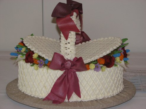 royal iced basket with edible flowers and bow